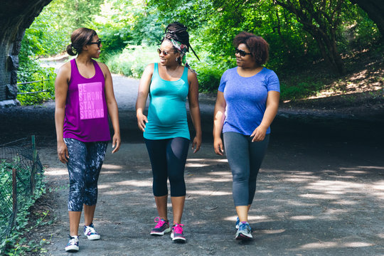 Smiling women walking in the park