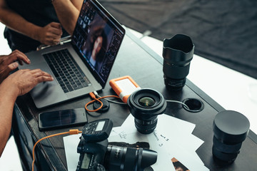 Equipments of a photographer on a table