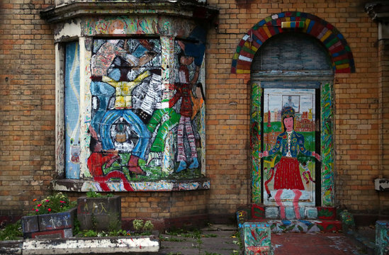Graffiti covers the exterior of a derelict house on Ducie Street in Liverpool