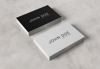 2 Stacks of Business Cards on Concrete Mockup