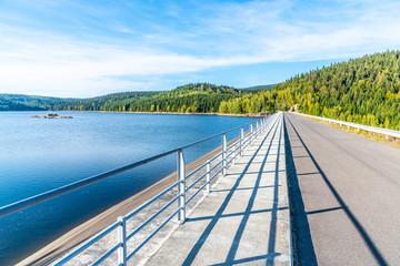 Josefuv Dul Dam, Earth-filled dam in Jizera Mountains with asphalt road on the top, Czech Republic. Sunny summer day.