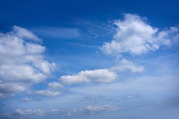 Blue sky white summer cumulus clouds