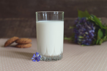 a glass of milk and oatmeal cookies, rustic style