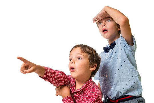 two adorable young boys looking ahead, isolated on white background