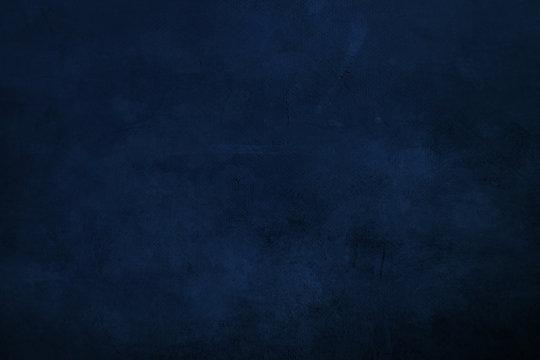 DArk blue  grungy canvas background or texture with dark vignette borders
