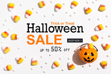 Halloween Sale message with pumpkin overhead view on a solid color