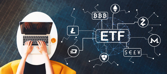 Cryptocurrency ETF theme with person using a laptop on a white table