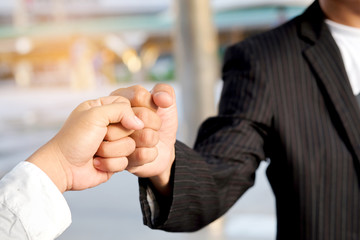 Hand of people fist Bump assemble corporate Meeting Teamwork and harmonious Symbol
