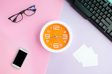 Workspace desk with ,business cards and clock .Lifestyle modern colorful background Top view