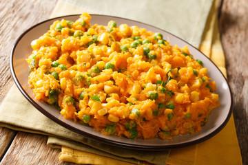 Kenyan vegetarian meal Irio puree of sweet potato with green peas and corn close-up on a plate. horizontal
