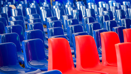 Rows Of Red And Blue Empty Plastic Seats At The Event. Blue Wave, Democratic Election Concept.