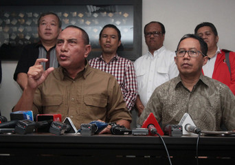 Indonesian Soccer Association (PSSI) Chairman Edy Rahmayadi and Vice Chairman Joko Driyono talk to reporters regarding the suspension of the League 1 football competition in Jakarta