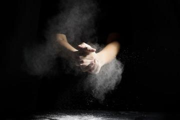 hand with flour dusk on blackboard