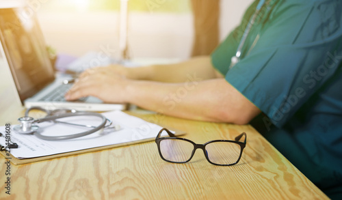9f22d7646f2a glasses on note book