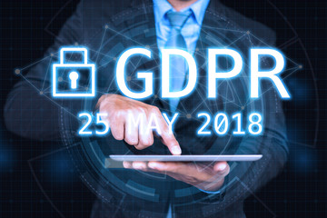 GDPR Concept,Businessman hand holding digital tablets sign general data protection regulation and key icon, Cyber security and information privacy,25 may 2018.