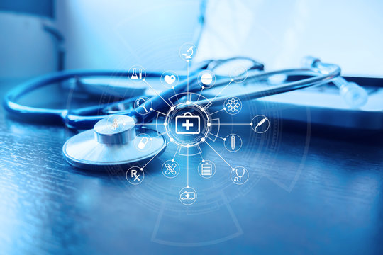 Stethoscope and laptop keyboard with icon on desktop in hospital,relax time doctor,medical concept,selective focus,vintage color.morning light