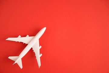 Airplane model. White plane on red background.  Wall mural