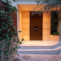 contemporary design house entrance dark brown door, illuminated