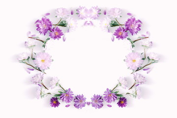Flowers composition. Frame made of fall flowers on light pastel pink background. Autumn flowers concept. Flat lay, top view, copy space