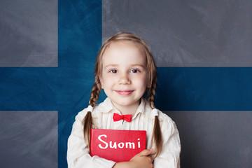 Learning finnish language. Smart child girl on the Finnish flag background