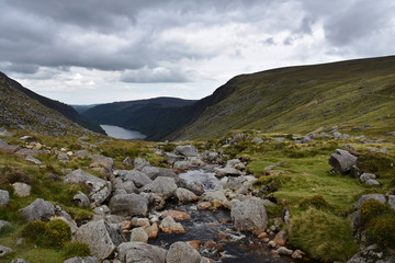 Irish mountain landscape stock images. A beautiful irish mountain landscape with a lake in summer. Ireland mountains landscape scenic green scenery