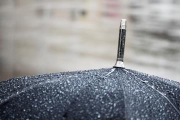 A black umbrella under rain