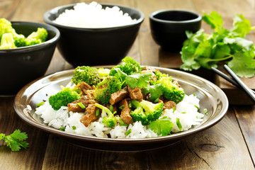 Beef with broccoli and rice. Asian cuisine.