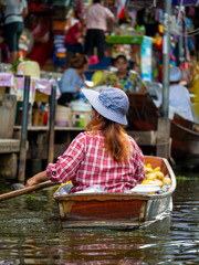 floating Market in Thailand and take a boat then have a great tour at Floating Market Damnoen Saduak, Thailand