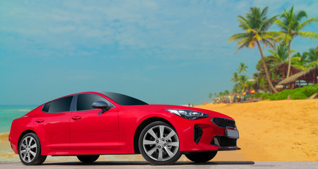 Red car on background of palm trees. Stylish, modern, bright image of car for design solutions.