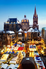 "Christmas Market ""Aachener Weihnachtsmarkt"" in Aachen, Germany at night on a winter day with snow"