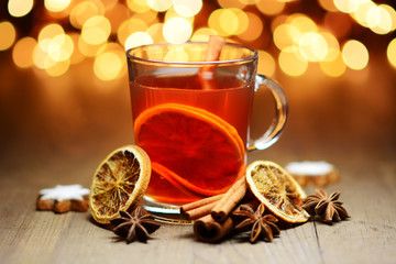 Punch, warm tea or mulled wine for Christmas with fairy lights as decoration and lighting