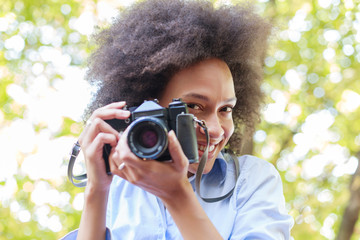 Charming Black Woman With Old Retro Camera In Nature