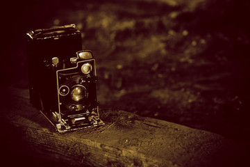 very old black retro camera, retro toned