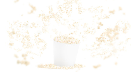 Blank white food bucket with popcorn mockup isolated on background, depth of field effect, 3d rendering. Empty paper fastfood box mock up. Clear pop corn pail, no gravity. Basket with falling corn.