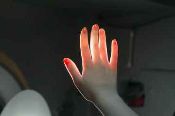 Female hand in front of sunlight