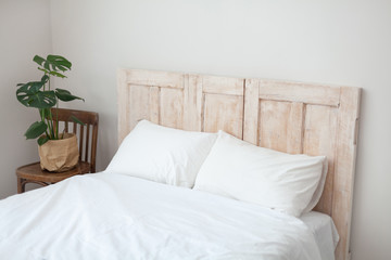 Scandinavian style bedroom. Succulent plant at the bed