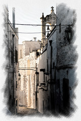 Scenic little street in the white village of Ostuni in Salento on the Adriatic sea