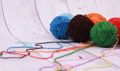 corlorful ball of yarn and white wood background