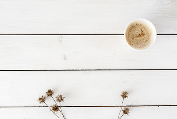 Styled stock photography white office desk table with dried flowers and coffee cup. Top view with copy space. Flat lay. Top view. Copy space for lettering, text, blogs, magazines, headers