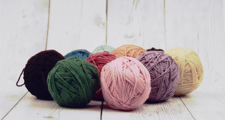 ball of yarn and wood background