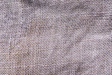 background of jute rugosa fabric texture of beige color