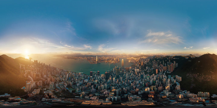 360 panorama by 180 degrees angle seamless panorama view of Downtown Hong Kong City at sunset. Skybox as background in equirectangular spherical equidistant projection for VR content