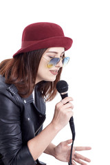 A young woman singing with a microphone