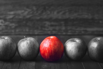 Right choice. Black and white photo with a red apple.