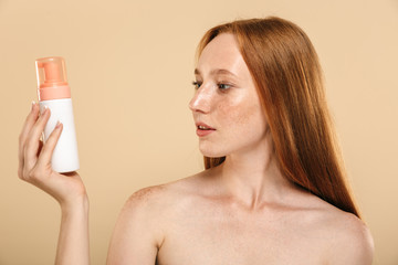 Beauty portrait of a healthy young topless redhead girl