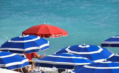 red lifeguard sunshade umbrella