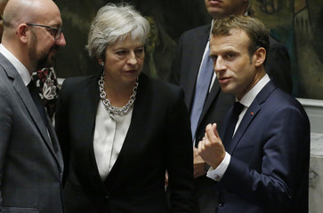 Britain's Prime Minister  May and France's President Macron chat before a meeting of the United Nations Security Council in New York