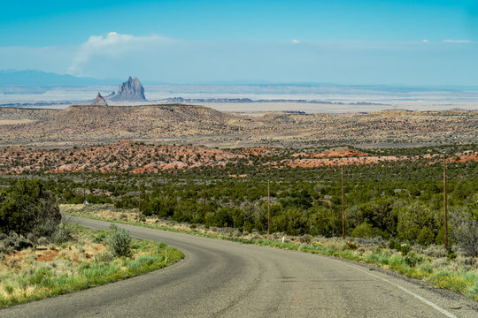 View of Shiprock rock formation in New Mexico from the Lukachukai Pass road in Arizona