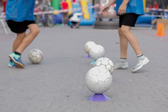 Children Training in Soccer academy, children's training with balls
