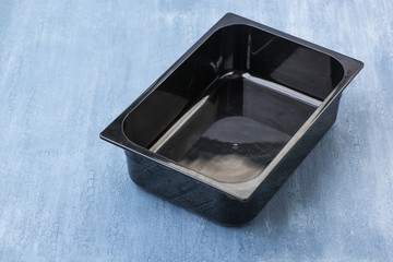 black empty plastic container for ice cream, top view